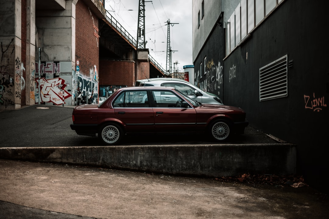 A car parked on the side of a building