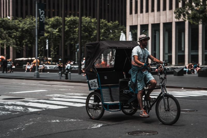 A man riding a bicycle on a city street